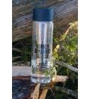 Läbipaistev pudel looduses.JPG